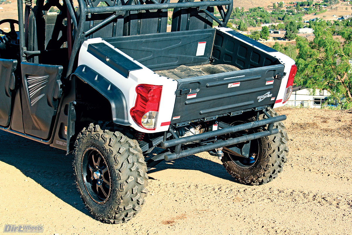 The electric dump bed only tips up this far. It comes with a rubber bed mat and locking toolboxes on top of each bed side. Turn signals are standard. Tires are 29-inch on 15-inch rims.