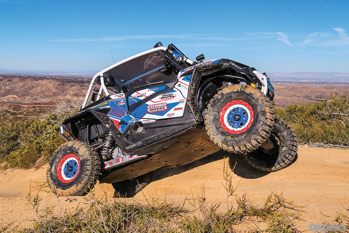 Factory UTV's UHMW plastic skid plate and rock sliders protect the belly of the RZR when the terrain gets toothy.