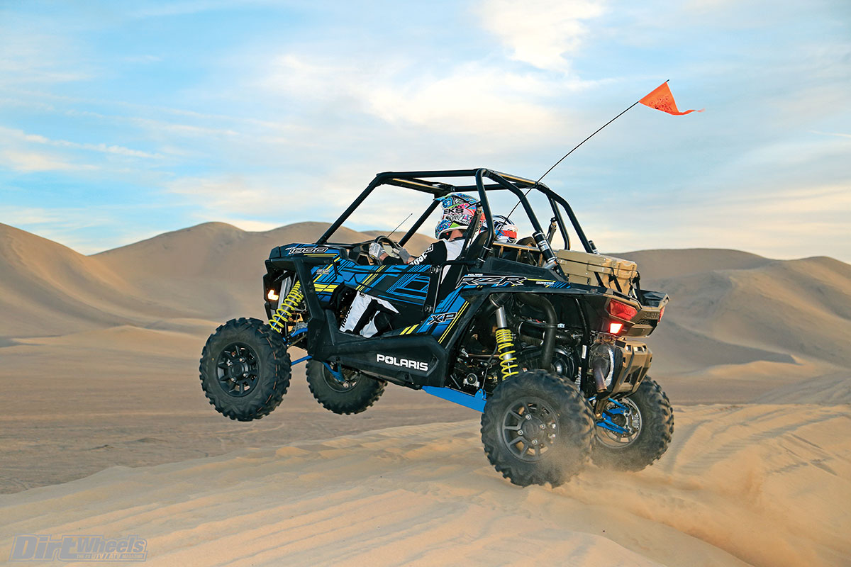 The front suspension has 16 inches of wheel travel, while the rear has 18 inches of wheel travel. The Polaris takes hard landings smoothly.