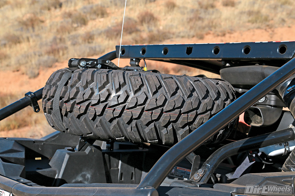(Top) Buckshot Racing's spare-tire carrier places the weight of the tire and wheel in an advantageous place for handling without totally blocking vision to the rear.