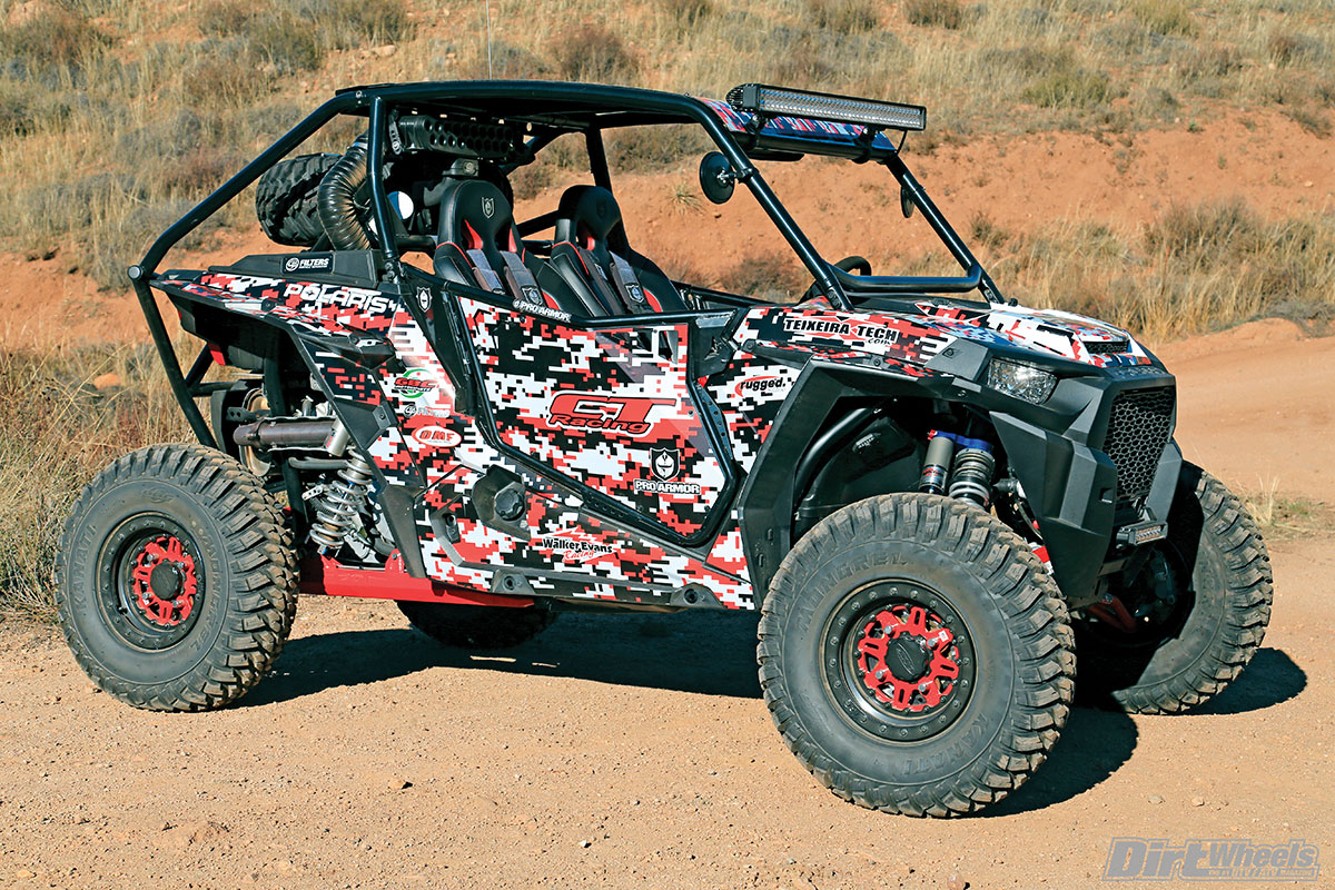 The digital camo wrap ties in nicely with the color-matched suspension arms and wheels. The tire carrier keeps the weight forward as much as possible without obstructing the rear-view mirror.