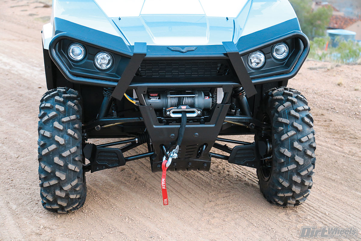 (Right) The Warn winch with a synthetic rope proved useful for work and once when we got high-centered on a trail ride. Those loops on the front work great for tying the machine down for transport.