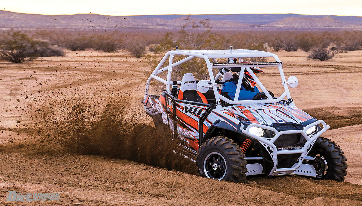 Before we adjusted the RZR S 800 ride height, ground clearance was an issue, but it still turned well.