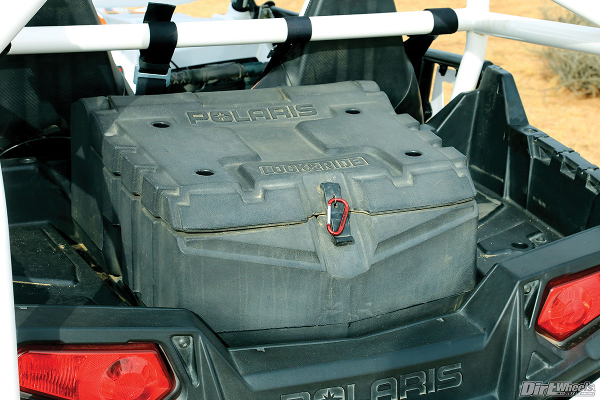 The Polaris Lock & Ride box has held up well. It carries emergency supplies for on-the-trail repairs.
