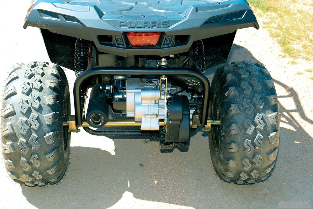 The rear swingarm is a large unit that includes the axle, engine, CVT, and exhaust and air cleaner. The entire unit pivots with two shocks for control.