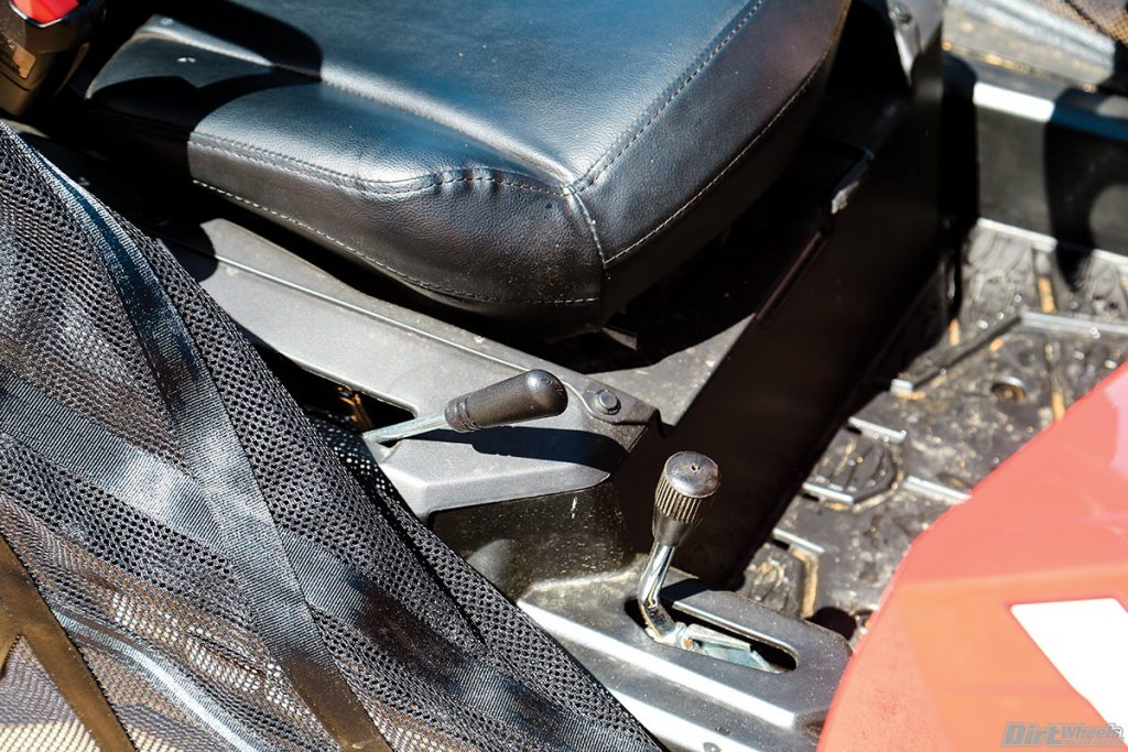 The forward/neutral/reverse shifter is on the right side of the seat with the parking braking mounted just forward of the shift lever.