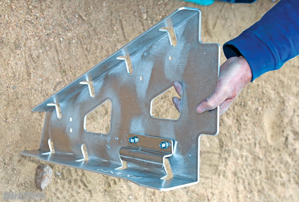 Each Axiom A-arm guard uses two of these brackets. We found that it was faster to mount one bracket with the nuts barely started rather than attempt to hold the part and line up the mounting hardware.
