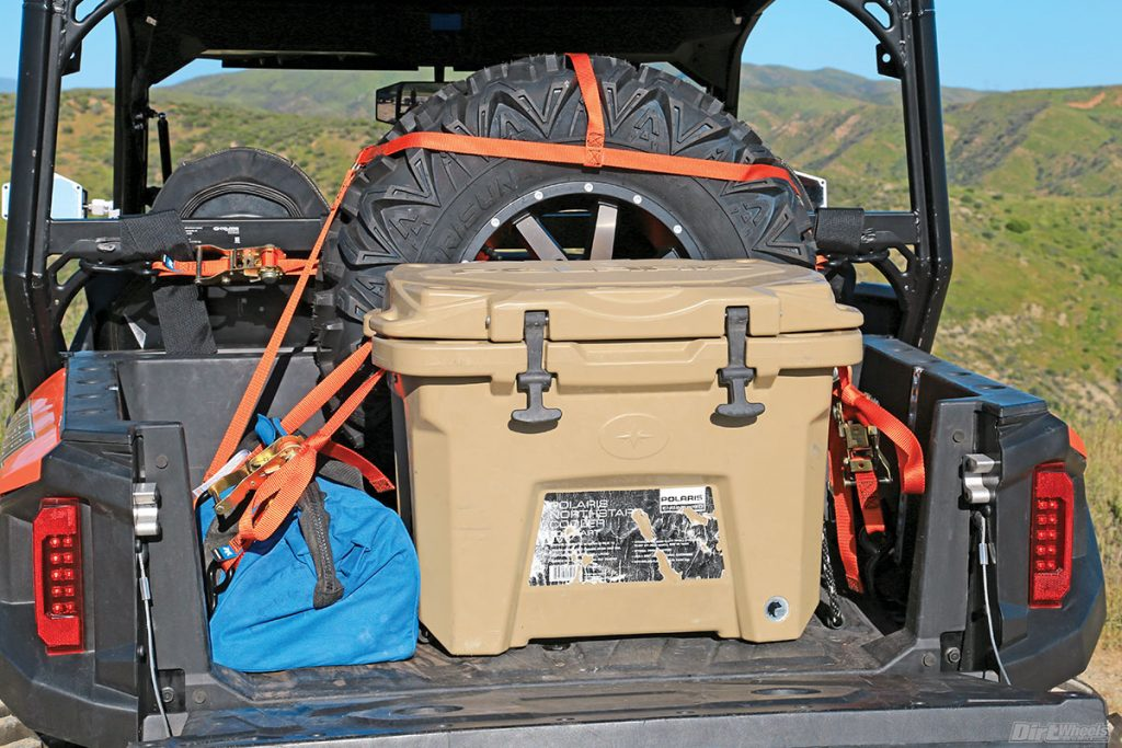 Mac's Custom tie-downs sent us a tie-down kit and an anchor rail system for the build. They also built a tire strap to help us tie down a spare tire. A Polaris Northstar cooler was also added to the build. As you can see, we love using it!