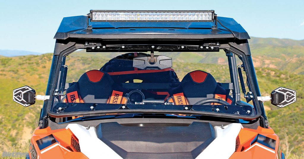 SuperATV has a flip-up windshield system that works great. It can be driven in the open, partially open or closed position. We installed Assault Industries' B2 Bomber mirrors that work great, and the Slasher LED light bar is very bright.