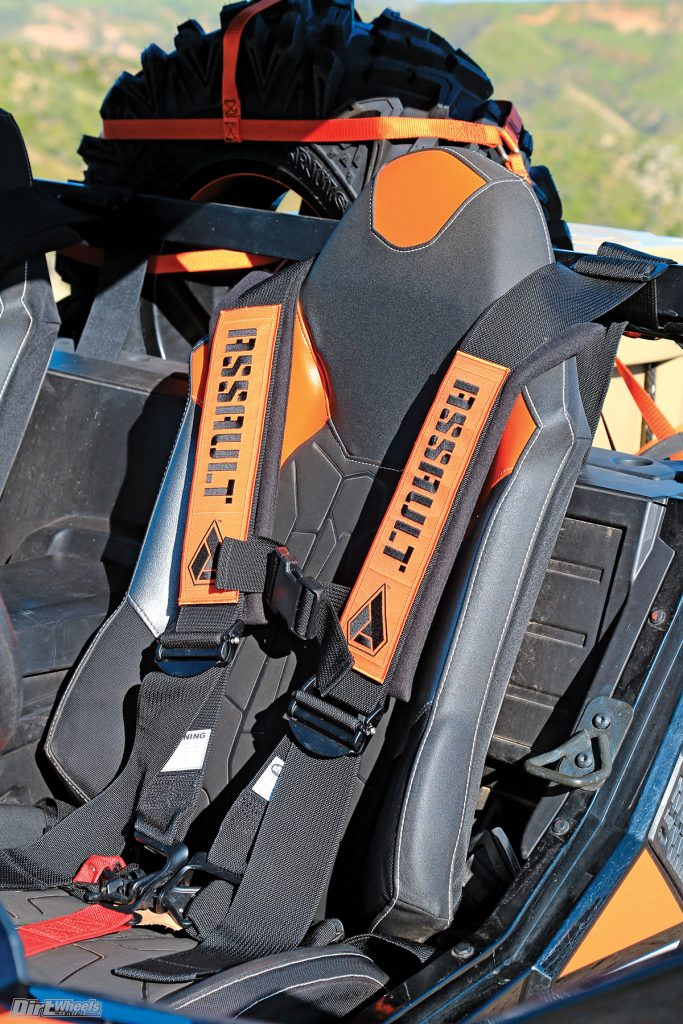 Assault Industries has five-point harness systems with removable padding for washing. They hold us steady in our seats.