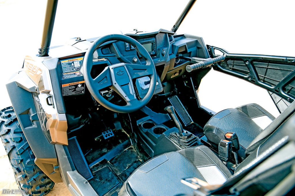 The Polaris' cockpit is comfortable and easy to reach the storage compartments. The seats are more comfortable than the Can-Am's with an upright position.